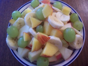 peaches, green grapes, apples and bananas